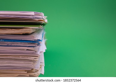 stack of paper against a green background