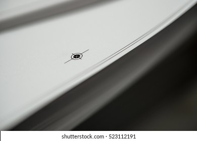 stack of paper with aligning marks in print shop