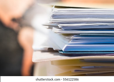 Stack of Papers Against Grunge World Map