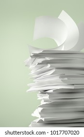 Stack of Papers against a plain color background
