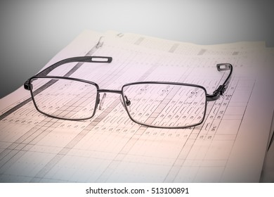 Stack of papers and glasses lying on table