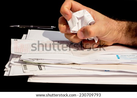 stack of paperwork and bills to pay