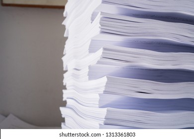 Stack of paperwork and document of report files on overload work on desk office, Stress papers and piles of unfinished documents achieves, Business paper sheet and information overload concept