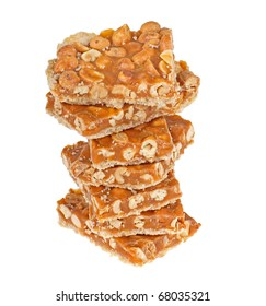 Stack of peanut butterscotch bars isolated on white