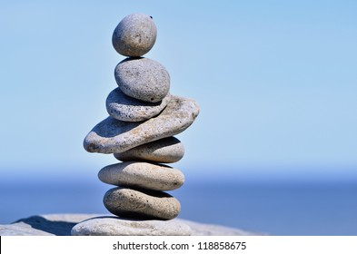 Stack of pebbles. Balancing on a sky background