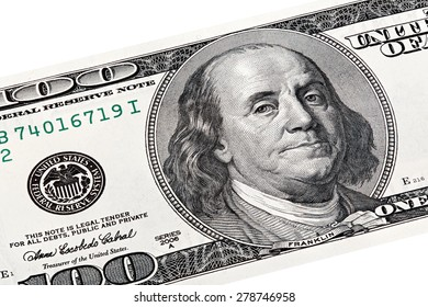 Stack photo of Benjamin Franklin, Federal Reserve System print on one hundred dollars bill.