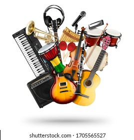 stack pile collage of various musical instruments. Electric guitar violin piano keyboard bongo drums tamburin harmonica trumpet. Brass percussion studio music concept isolated on white background