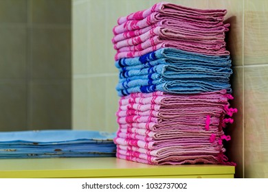 Stack of pink bath towels close-up with blurred background