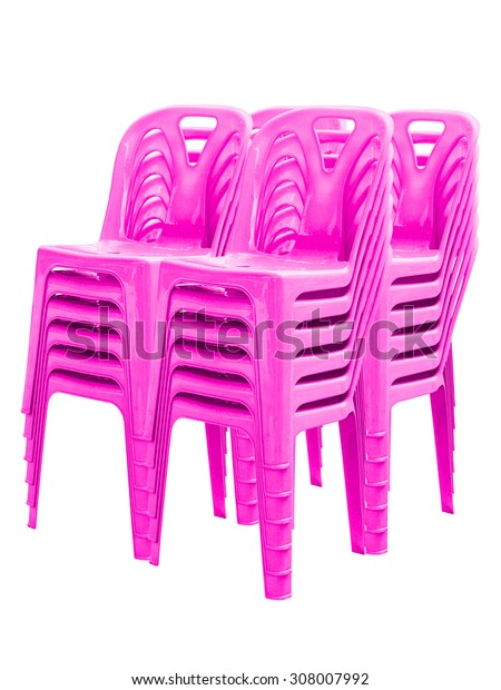 Stack of pink plastic chairs on white