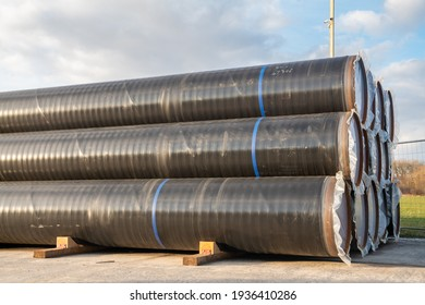 A stack of pipes on the construction site of a gas pipeline that will be laid on the seabed