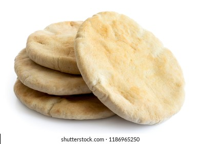 A stack of pita breads isolated on white from above.