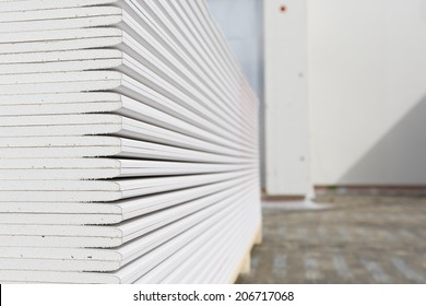 Stack of plasterboard panels at construction site
