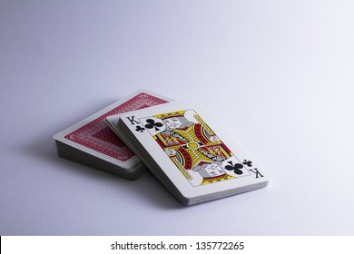 stack of playing cards with king facing up