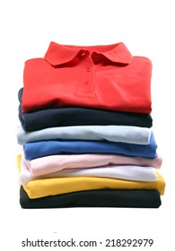 stack of polo shirts isolated on white