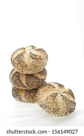 A stack of poppy seed rolls on a white background