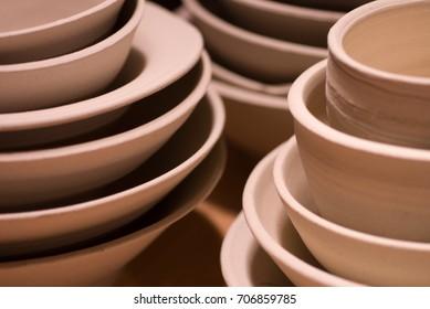 Stack of porcelain ceramic bowls and vessels