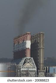 Stack of power station emitting smoke