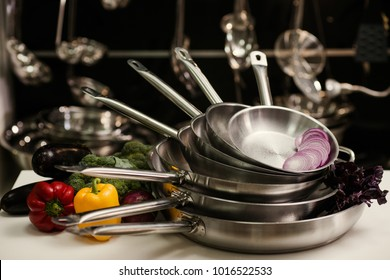 Stack of professional kitchen pans. Restaurant cooking untensils. Healthy food and proper nutrition concept