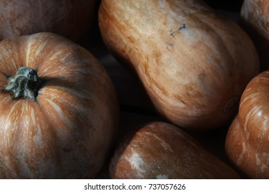 Stack of pumpkins on a wooden table. Close-up