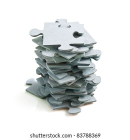 Stack of Puzzle Pieces on White Background