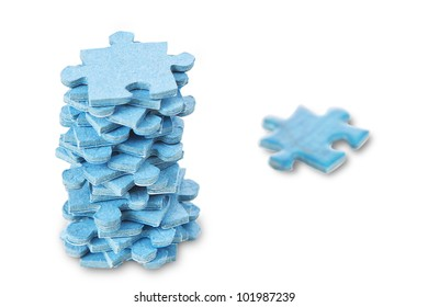 A stack of puzzles on a white background.