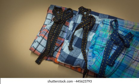 stack of pyjamas on gray grunge background.