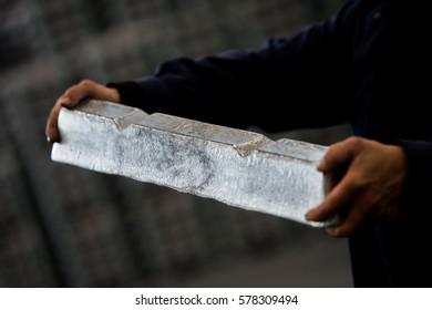 Stack of raw aluminum ingots in aluminum profiles factory, France