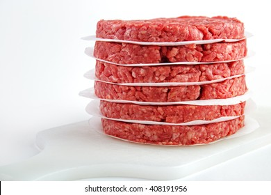 Stack of raw fresh burger patties from beef meat