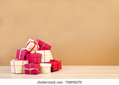 Stack of red and beige gift box on wooden background, Christmas concept