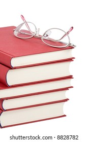 stack of red books with eyeglasses