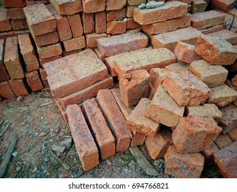 stack of red brick near construction site