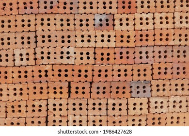 Stack of red bricks ready for construction site