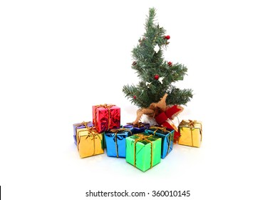 stack of red gift boxes decorated with Christmas Tree isolated on white