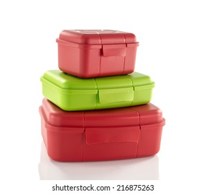 stack of red and green lunchboxes isolted on white
