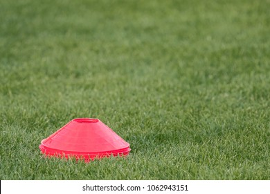 Stack of red markers on a green grass