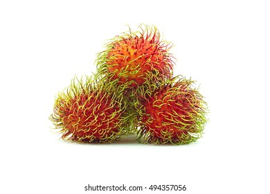 Stack of red rambutan on white background