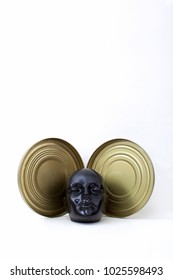 Stack of reels of old movies and black dummy head on white.Concept cinema