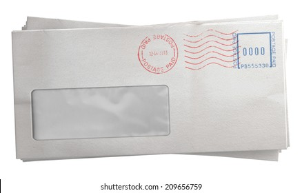 A stack of regular white envelopes with delivery stamps and a clear window on an isolated white background