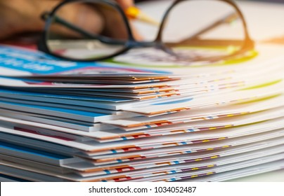 Stack of report paper documents for business desk with glasses, Business papers for Annual Report files, Document is written,presented. Business offices concept, soft focus