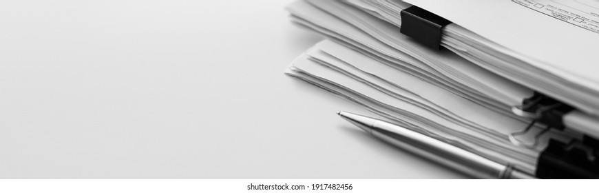 Stack of report paper documents. Concept of business and financial data analysis.