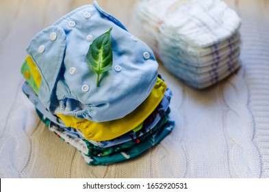 Stack of reusable nappies. Ecological trend for baby care. Washable cloth diapers. Eco friendly diapers vs pampers