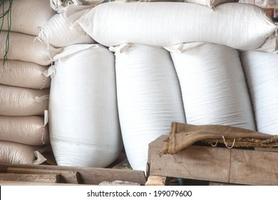 Stack of rice and animal feed bags