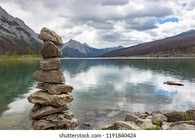 A stack of rocks by Medicine Lake in Jasper National Park in Alberta