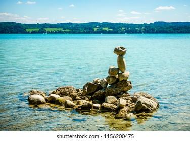 stack rocks at a lake