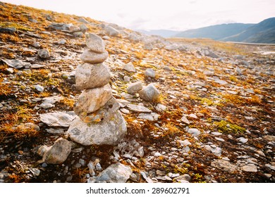 Stack Of Rocks Stones On Norwegian Mountain, Norway Nature. Toned Instant Photo
