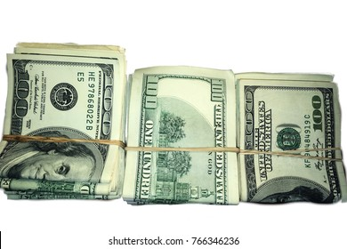 Stack of Rolled US Dollar Bills on white background