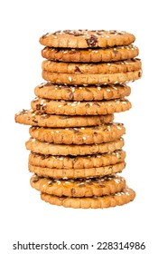 Stack of round cookies with sesame and flax seeds isolated over white background