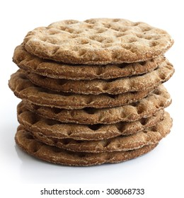 Stack of round rye crispbreads isolated on white.