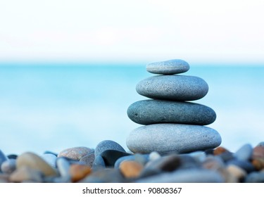 Stack of round smooth stones on a seashore