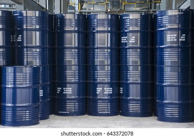 Stack of rubber latex iron barrels prepare for liquid product export.